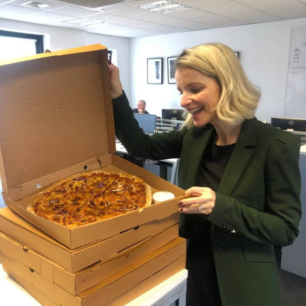 Culture at Cpl employee enjoying pizza
